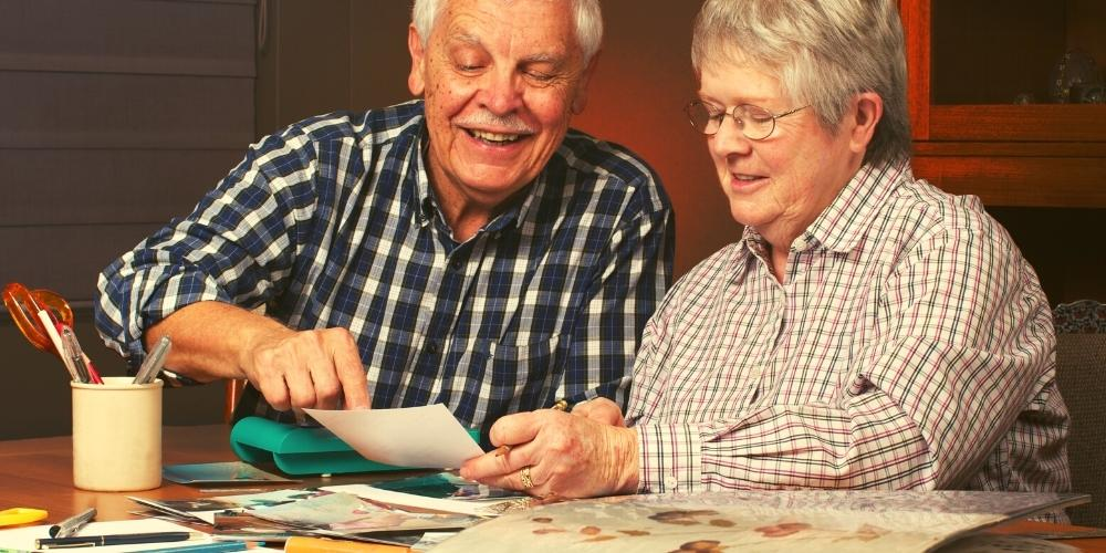 Older people looking at photos together as a fun relaxing activity to do together.