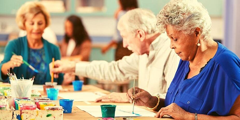 Seniors at a community painting group.