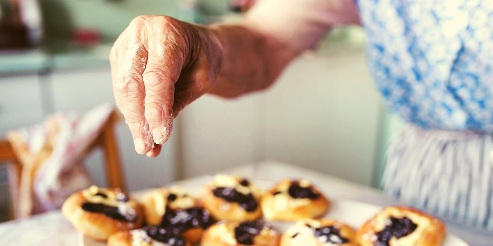 A photo of an elderly dementia patient enjoying cooking and baking.