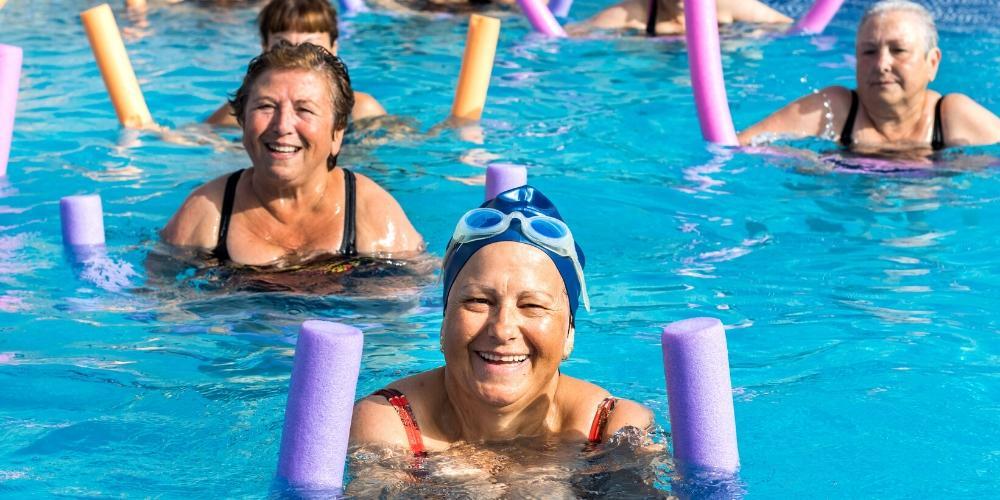 Seniors enjoying swimming and aqua aerobics